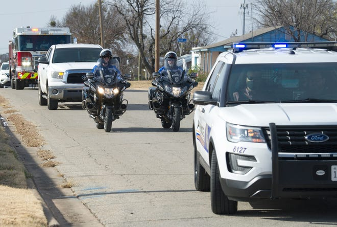 In this file photo, Wichita Falls Police and Firefighters delivered gifts to the Children's Aid Society of West Texas in December. A survey found a majority of Texans have a favorable view of their local law enforcement.