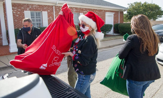 Wichita Falls Police played Santa's little helpers Friday afternoon delivering gifts to the Children's Aid Society of West Texas.
