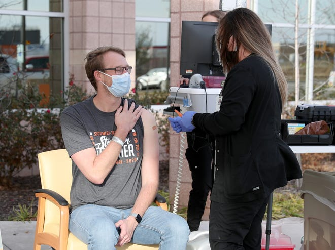 Shane Statham, along with three other United Regional staff members, received a COVID-19 vaccination Friday, Dec. 18, 2020, outside the Barnett Road Medical Building.