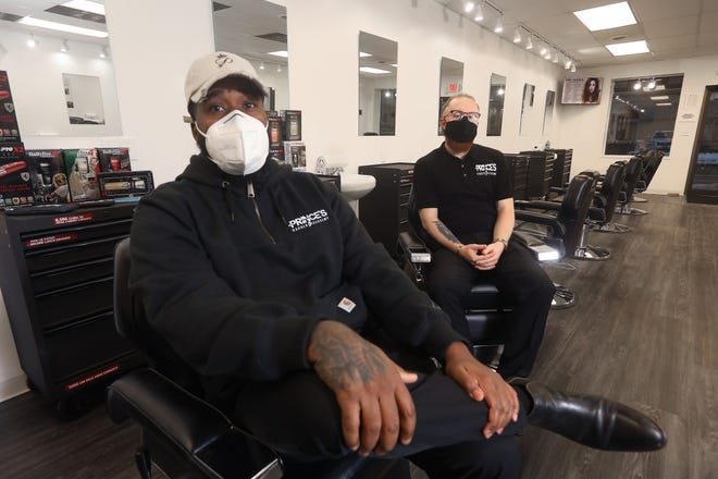 Prince Fields, left, known as the Prince of Cuts, and Travis Campbell will open Prince's Barber Academy in downtown Zanesville next month.