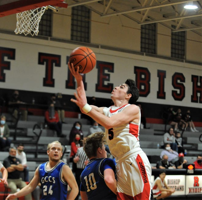 Rosecrans' Thomas Spohn drives for a layup in the third quarter of Thursday's 74-42 win against Grove City Christian at Rogge Gymnasium.
