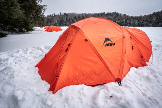 Make sure your cold-weather tent is snug and dry to keep the snow from creeping in.