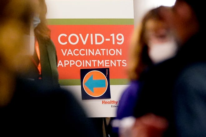 A sign for COVID-19 vaccination appointments on Thursday at Edward Hospital in Naperville, Ill.
