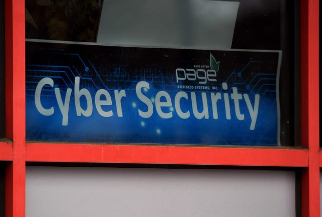 """A """"Cyber Security """" sign is displayed in the window of a computer store in Arlington, Virginia.  A devastating cyberattack on U.S. government agencies has also hit targets worldwide, with the list of victims still growing, according to researchers, heightening fears over computer security and espionage."""