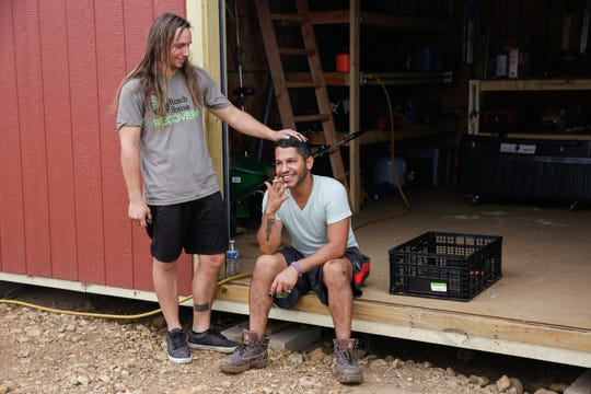 "Residents Chris Weber, 29, left, and Pablo Quintero, 29, take a break after harvesting vegetables at Simple Promise Farms in Elgin, Texas on Friday, Nov. 13, 2020. Quintero said when he arrived to the program he was fearful that no one would accept him. ""Being a person of color and being Queer as well I was scared because in treatment places I know it's all going to be cisgender, white males,"" he said. ""The guys have really proved me wrong."""