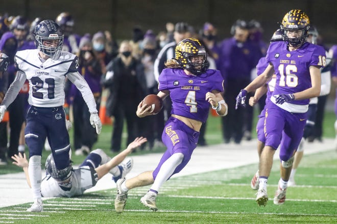 Liberty Hill quarterback Charlie Calabretta weaves his way for a 64-yard gain during the Panthers' 41-0 win over Boerne Champion Friday in a Class 5A Division II area round playoff game. The Panthers rushed for 516 yards as a team in the victory.