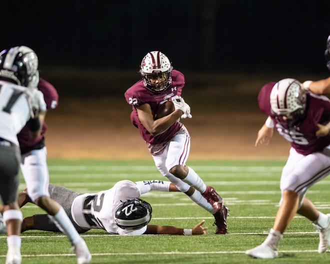 Round Rock running back Israel Morgan eludes Cibolo Steele's Raman Thomas during the Dragons' 26-19 loss in a Class 6A Division I area-round playoff game Friday at Kelly Reeves Athletic Complex. Morgan rushed for a game-high 172 yards and a touchdown.