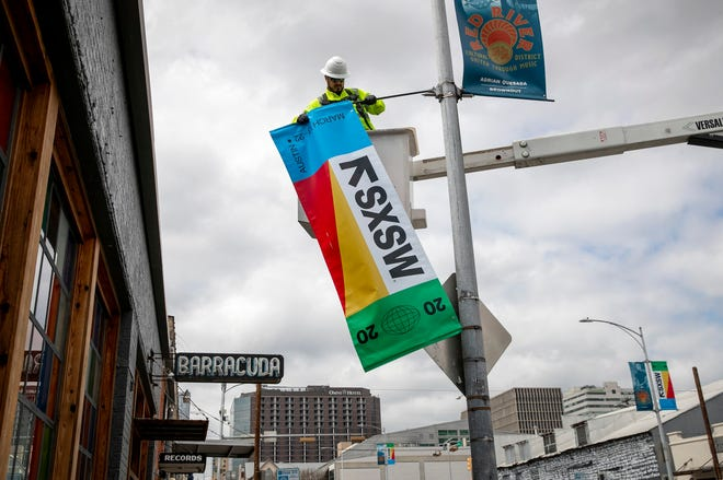 Banners for the South by Southwest festival were taken down in March, after the event was canceled because of the coronavirus pandemic. Cancellation of SXSW and other big tourist draws in 2020 were body blows for many local businesses that depend on them for big portions of their annual revenue.