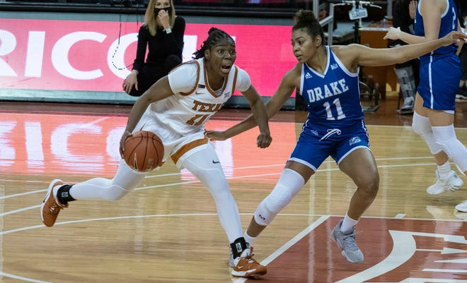 Texas guard Joanne Allen-Taylor tries to drive past Drake's Kierra Collier during the Longhorns' 101-80 win Friday night at the Erwin Center. It was the second time this season Texas has scored 100 points.