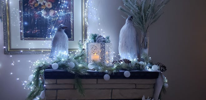 Penguins sit atop the mantel inside Walker's formal living area.