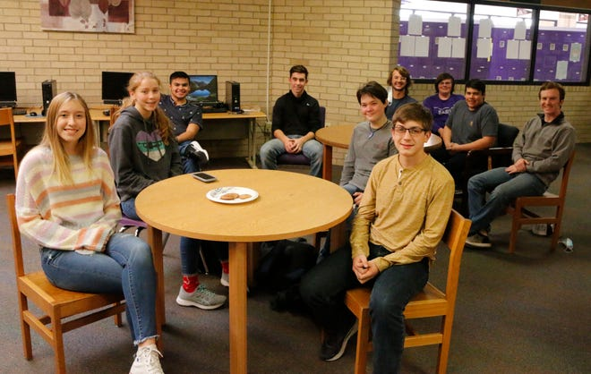 Early Problem Solvers include: table in foreground, from left, Tristin Rasor, Andie Tidwell, Sidney Becktold, Calvin Clubb; back, from left,  Asher Callaway, Korbin Barr,  Cooper Neel, Ty McConn, Aaron Callaway, Seth LaRue.