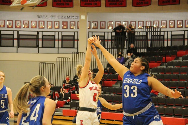 Brooklyn Motter (0) attempts a bucket against Winfield on Friday, Dec. 18 at El Dorado High School. Motter finished with two points in the 32-22 loss to Winfield.
