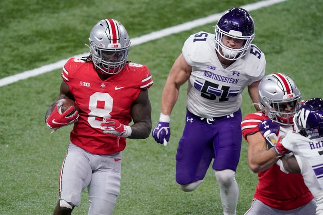 Ohio State's Trey Sermon runs for the end zone past Northwestern linebacker Blake Gallagher on Saturday.