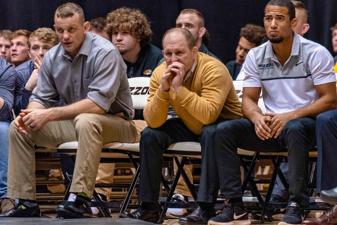 Missouri head wrestling coach Brian Smith, center, looks on during a dual against Ohio on Jan. 10 at the Hearnes Center.