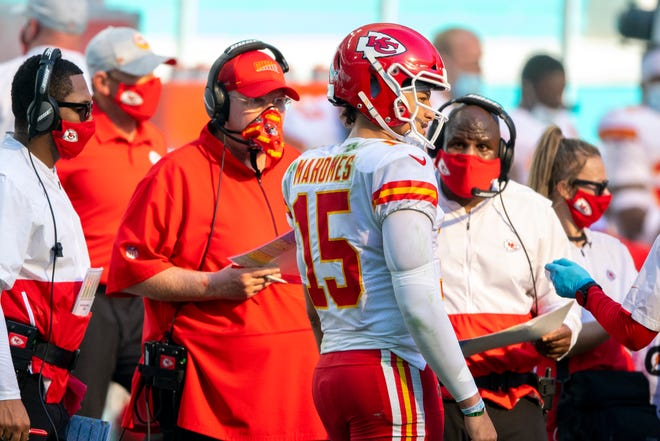 From left, Kansas City Chiefs head coach Andy Reid, quarterback Patrick Mahomes (15) and offensive coordinator Eric Bieniemy talk on the sidelines during a game against the Miami Dolphins last Sunday in Miami Gardens, Fla.