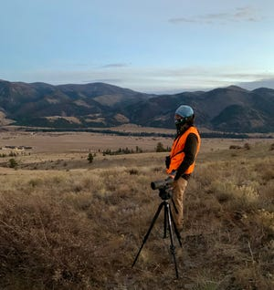 New hunter Jeremey James uses a Maven spotting scope to search for mule deer in Colorado.