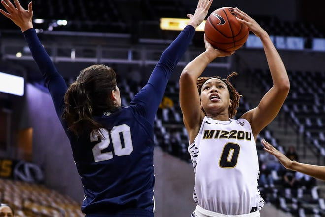 Missouri forward LaDazhia Williams (0) shoots the ball during a game against Oral Roberts on Saturday at Mizzou Arena.