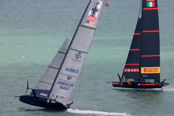 U.S. yacht American Magic, left, and Italy's Luna Rossa compete in the America's Cup World Series in Auckland, New Zealand on Friday.
