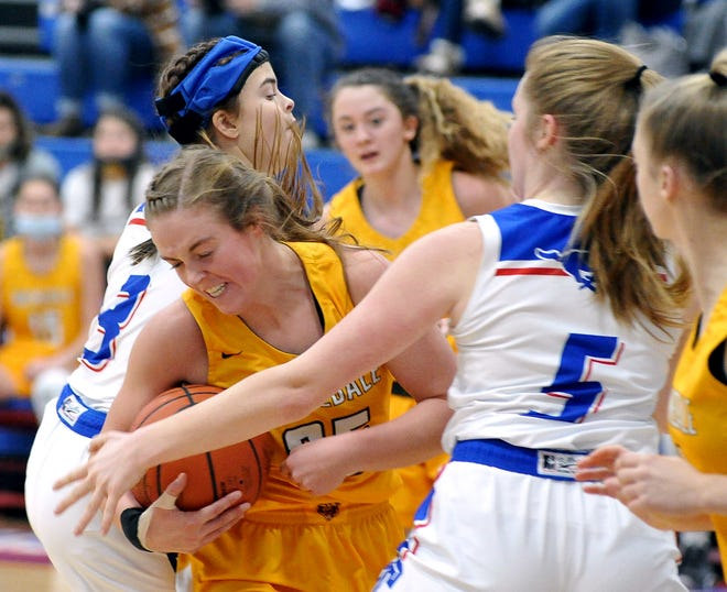 Tuslaw's Brianna Fitzgerald, left, and Waynedale's Brooklyn Troyer battle for a rebound during the teams' regular-season meeting.  (The Daily Record / Mike Schenk)