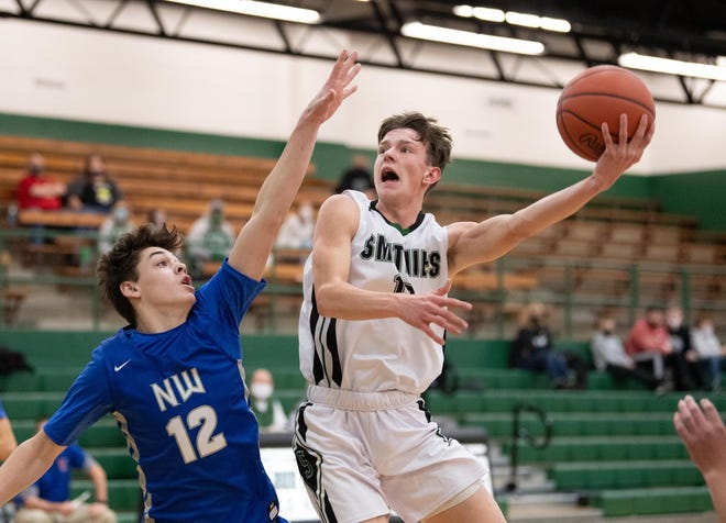 Smithville's Carter Piatt attacks the basket for two of his 26 points in a win over Northwestern.