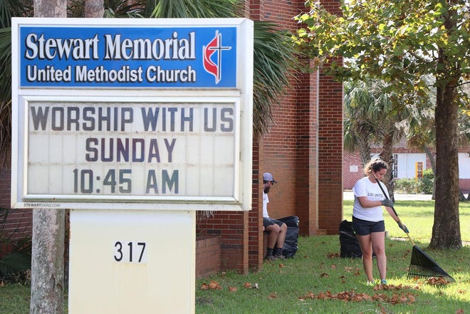 Volunteers clean the grounds of Stewart Memorial Church after Hurricane Irma.