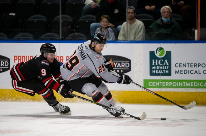 Kansas City Mavericks forward Giorgio Estephan, right, tries to get around the Indy Fuel's Seamus Malone (9) during a game earlier this season. Estephan, who is tied for second in the ECHL with 22 points, was called up to the AHL by the Stockton Heat Wednesday.