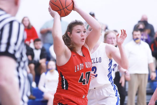 W-MU's Bradie Buffington looks to pass the ball out of the lane in their win over Wapello.