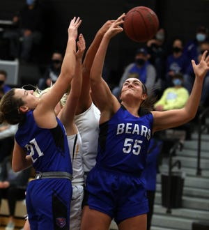 Danville High School's Drew Fox (55) pulls down the rebound during the first half of their game against New London High School, Friday Dec. 18, 2020 in New London.