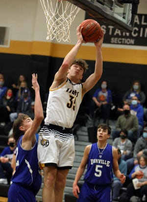 New London High School's Kade Benjamin (35) goes up for a basket during the first half of their game against Danville High School, Friday Dec. 18, 2020 in New London.