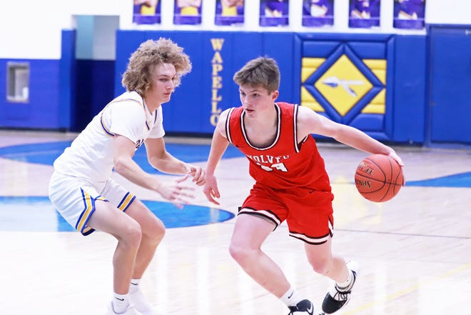 WMUs Cam Buffington takes the ball upcourt guarded by Wapello's Griffin Mears