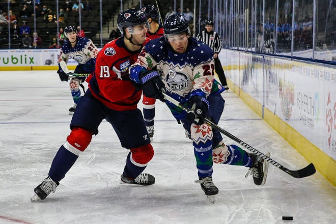 Jacksonville Icemen forward Ara Nazarian (22), right, advances the puck defended by South Carolina Stingrays forward Cameron Askew (19) during a matchup in December.