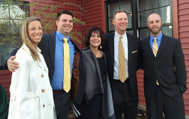 A member of both the Murdock Athletic High Hall of Fame and the Massachusetts Football Coaches Hall of Fame, Dale Diamantopoulos, second from right, met his wife Susan, center, at Springfield College and the couple settled in Lunenburg to raise their children (from left ot right): Krista, Michael and Peter.