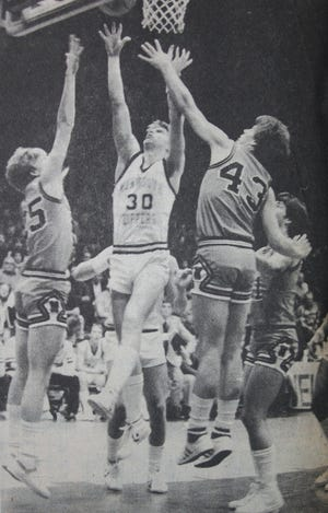 John Kinney rises for a putback basket against Macomb at the Macomb Holiday Tournament. Every point was valuable in that quarterfinal game, which the Zippers won 70-69 in double-overtime. Despite not being a starter, Kinney earned All-Olympic Conference honors at the end of the season.