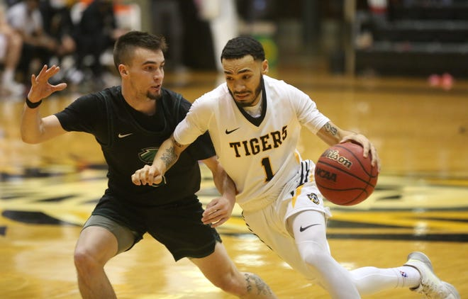 Fort Hays State's Quinten Rock drives to the basket as Northeastern State's Brad Davis defends during the Tigers' 81-76 win earlier this month. The Tigers will play at Missouri Western on Saturday.
