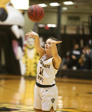 Fort Hays State's Jaden Hobbs dishes the ball inside during the TIgers' 80-60 win over Northeastern State on Friday.