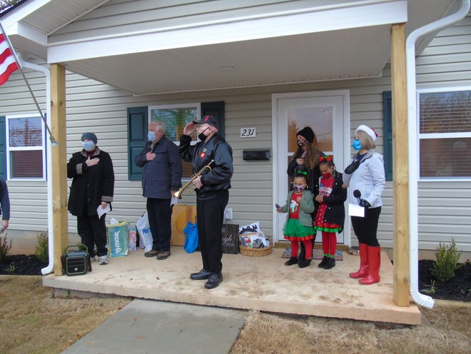 Habitat for Humanity dedicates its 150th home to Stevie Simmons. From left Vonda and Dave Mason, Ross Rumore, Simmons and her daughters Ka'leah and Heaven and Cindy Wagstaff, executive director, Garland County Habitat for Humanity