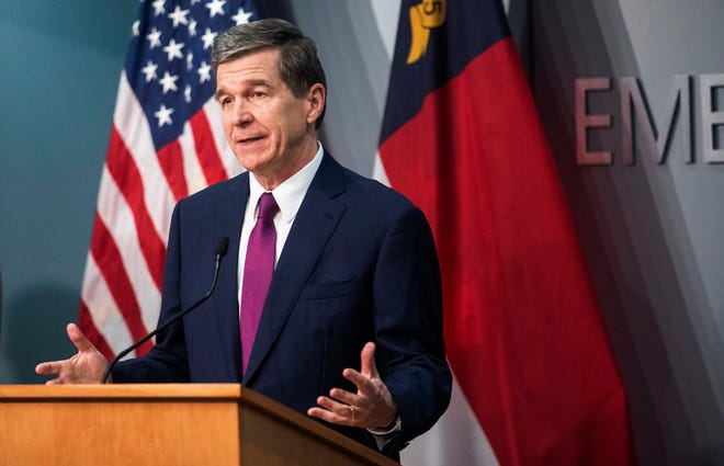 Gov. Roy Cooper speaks during a briefing on North Carolina's coronavirus pandemic response April 13 at the N.C. Emergency Operations Center in Raleigh. (Travis Long/The News & Observer via AP)