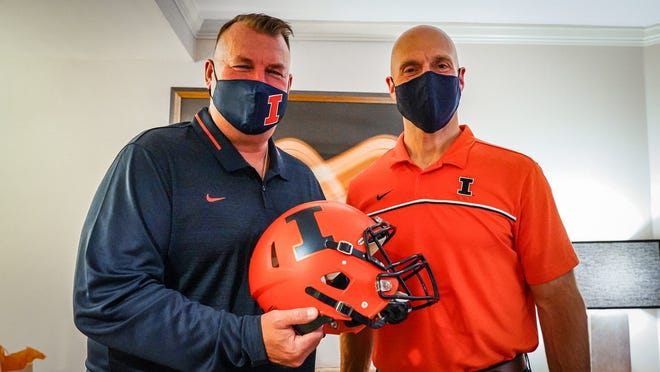 Illinois football coach Bret Bielema, left, stands with athletic director Josh Whitman. The Big Ten Conference school on Saturday hired Bielema, the former Wisconsin and Arkansas coach.