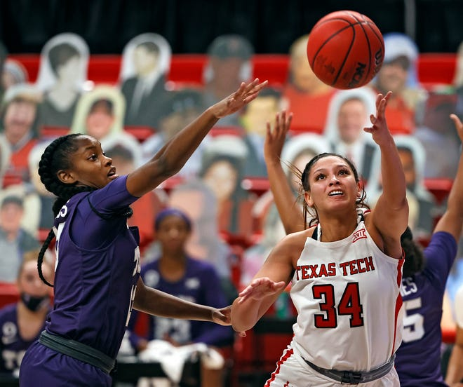 Texas Tech's Lexi Gordon (34) lays up the ball during the first half of a Big 12 Conference game Saturday at United Supermarkets Arena. Gordon finished with 24 points as the Lady Raiders claimed a 78-72 win.