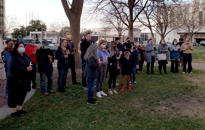 Drug court probationers, friends and family members of judge Ruben Reyes gathered Thursday night at the Lubbock County Courthouse for a candlelight vigil.
