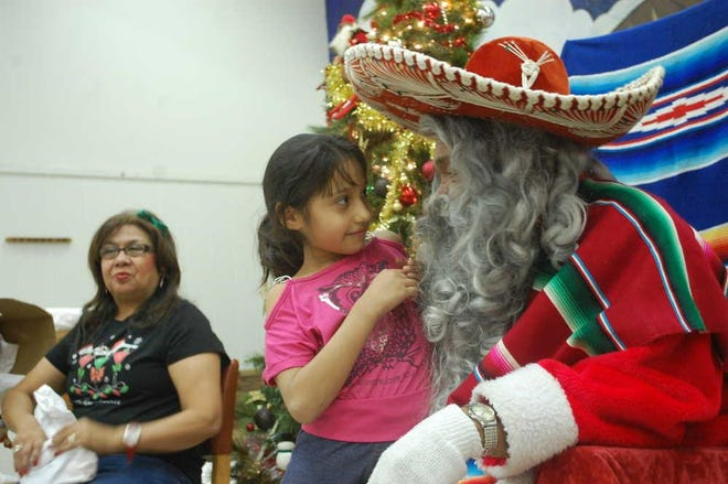 Pancho Clos during one of his visits with Lubbock children at the Maggie Trejo Supercenter.