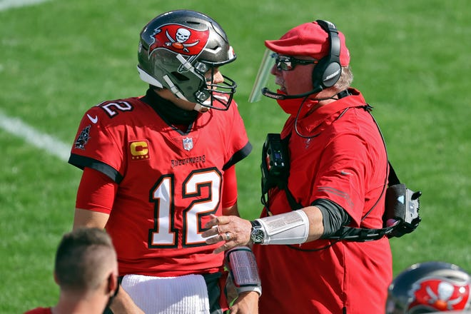 Tampa Bay Buccaneers head coach Bruce Arians congratulates quarterback Tom Brady (12) after a touchdown pass to wide receiver Scott Miller (10) during the first half of against the Minnesota Vikings on Dec. 13.