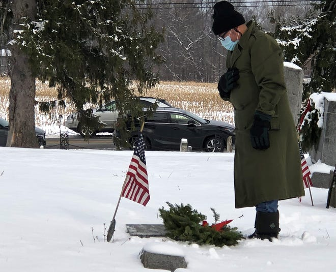 Jamie Frarey, of Canandaigua, says the name of Marjorie Sheldon Harnish, a veteran who is buried at South Farmington Friends Cemetery.