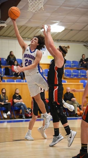 Mountainburg's Jodin Davidson goes up for the basket during Thursday's home conference contest against the Magazine Rattlers. Davidson scored 17 points as the Dragons won 67-62. (photo by Belinda Merritt/Special to the PRESS ARGUS-COURIER)