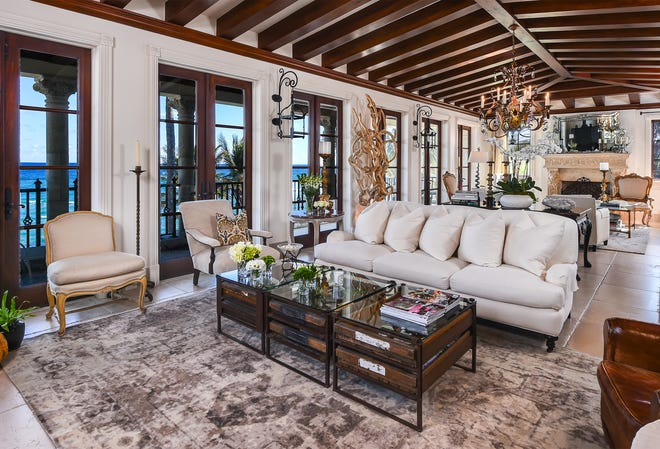 The oceanfront living room of the penthouse at 104 Gulfstream Road in Palm Beach is on the third level of the Las Ventanas building. The condominium just sold for a recorded $10.495 million.