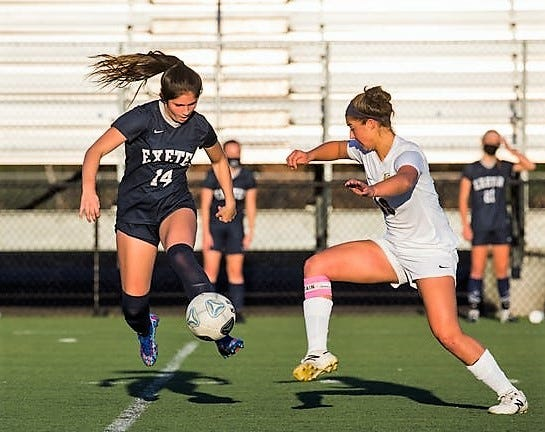 Exeter High School senior Ella Fraser, left, is shown here during last month's Division I girls soccer state championship game against Windham. Fraser had two goals and an assist in Exeter's 5-0 win.