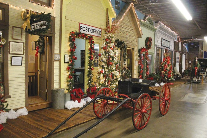 Christmas color abounds on the Main Street boardwalk in the Pratt County Historial Museum, now open for visitors on a few select days for the holiday season.