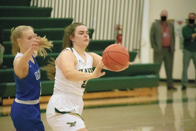 Rian Jamison passes the ball to a teammate on Friday, Dec. 18.