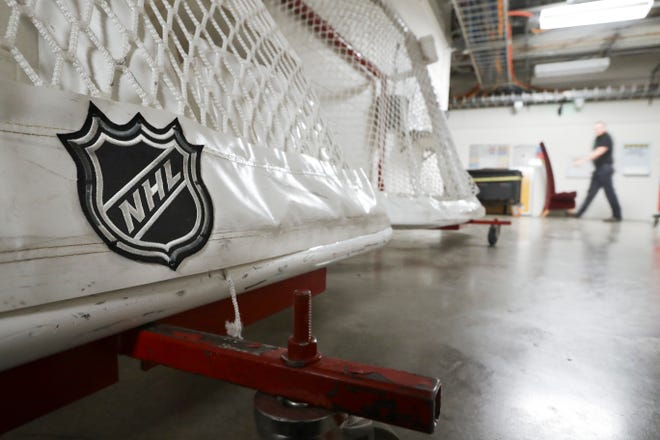 In this March 12, 2020, file photo, goals used by the NHL hockey club Nashville Predators are stored in a hallway in Bridgestone Arena in Nashville, Tenn. The National Hockey League and players reached a tentative deal on Dec. 18, 2020, to hold a 56-game season in 2021, pending the approval of each side's executive board and Canadian health officials.