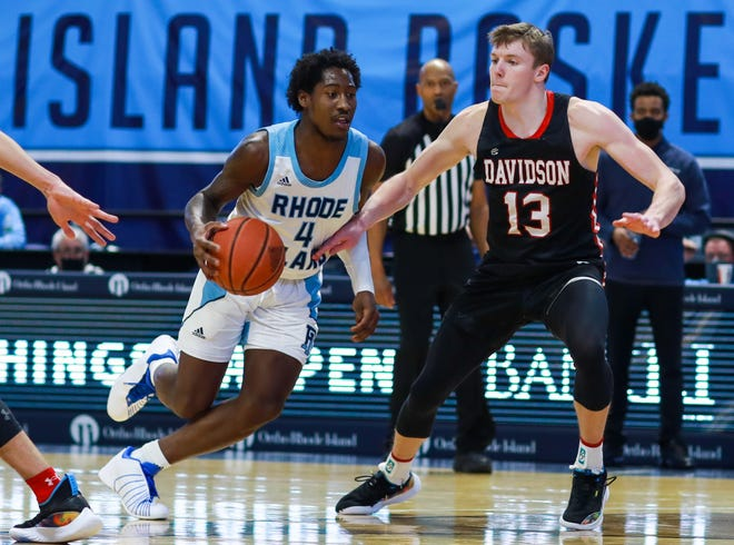 URI's Allen Betrand, left,  tries to drive past Davidson's Michael Jones during Friday night's game at the Ryan Center in Kingston.